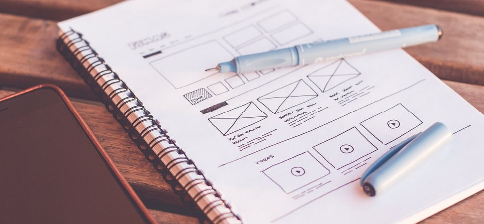 wireframe of a website page layout drawn on a notepad