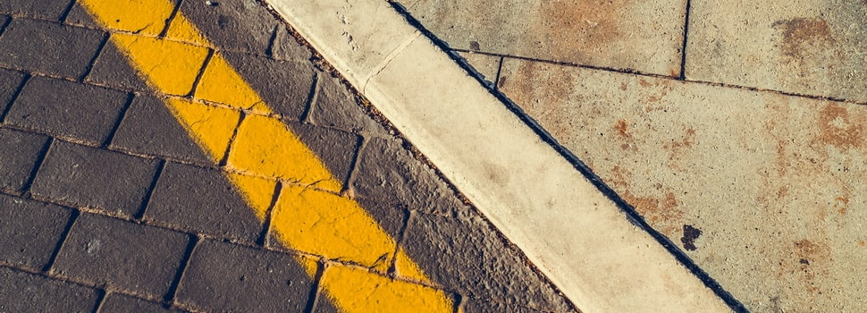 white and yellow paint lines on the road