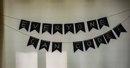 hanging sign saying everyone can code