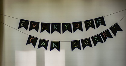 hanging sign saying everyone can code