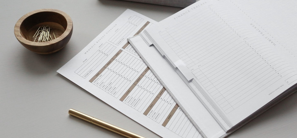 monthly budget and finance tracking documents lying on a table